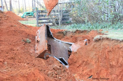 Crushing the old septic tank