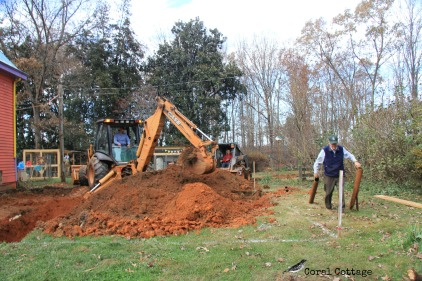 Dad hauls away the old septic piping