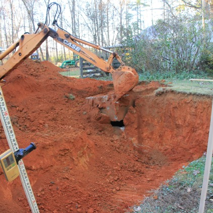 digging up the old septic tank