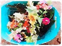 Flowers in blue bucket